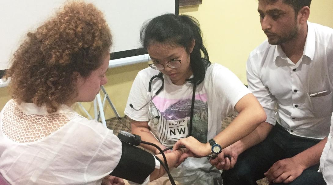 Projects Abroad interns practice their medical skills on the group during their work experience in Nepal